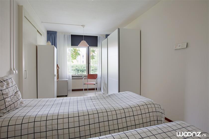 Vivium Oversingel - Weesp - groot 2-kamer appartement aan binnentuin met uitzicht op water van binnentuin - Slaapkamer 1