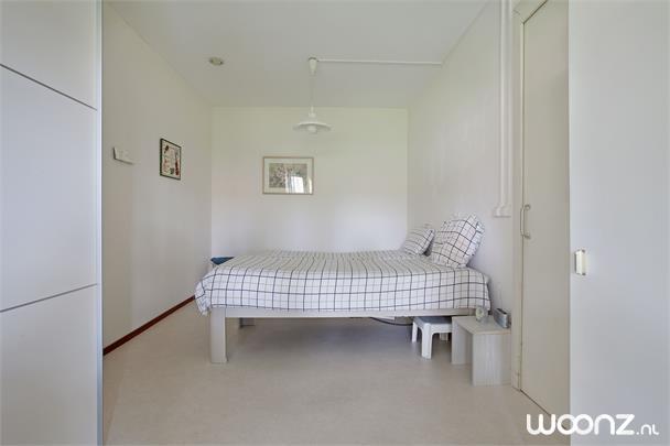 Vivium Oversingel - Weesp - groot 2-kamer appartement aan binnentuin met uitzicht op water van binnentuin - Slaapkamer