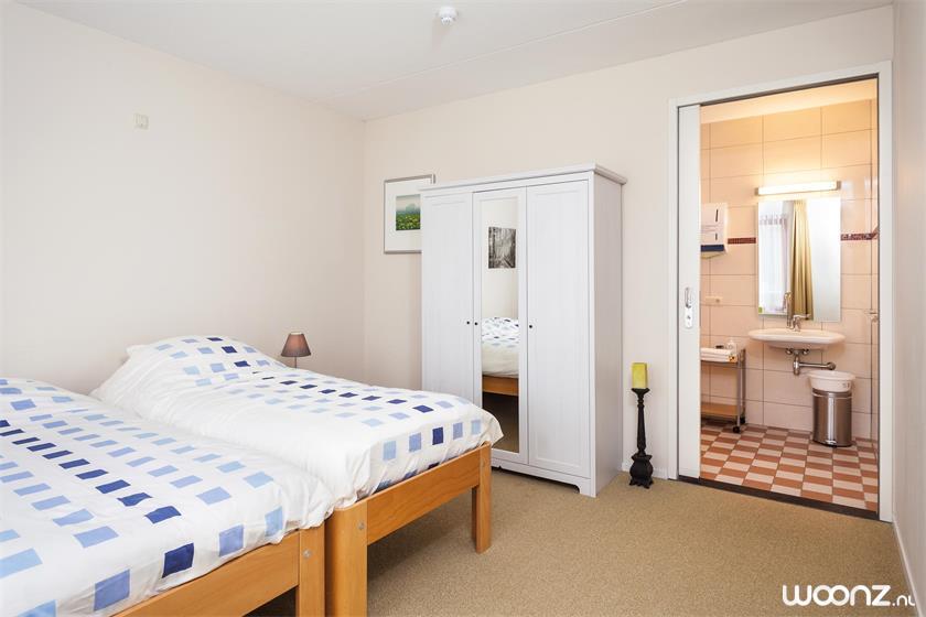Solace-appartement-slaapkamer-badkamer